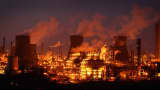 An illuminated Grangemouth Oil Refinery emits smoke on March 29, 2012 in Grangemouth, Scotland.