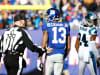 Odell Beckham of the New York Giants talks with a referee after a play with Josh Norman of the Carolina Panthers during their game at MetLife Stadium on Dec. 20, 2015, in East Rutherford, New Jersey.