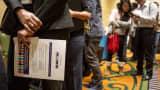 Job seekers wait in line to speak with recruiters during the San Jose Career Fair in San Jose, California.