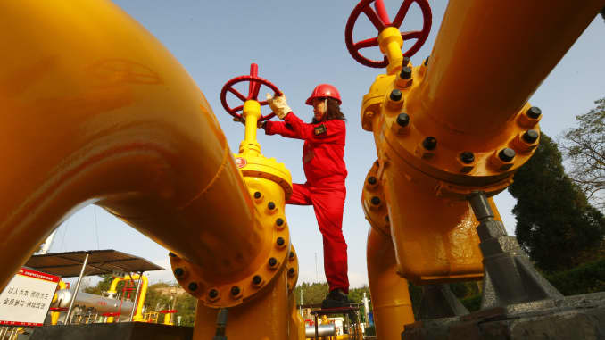 Premium: China oil and gas woman opening pipeline valve 101105