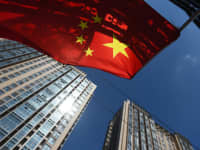A Chinese flag flies near apartment buildings in Beijing.
