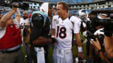 Carolina Panthers quarterback Cam Newton and Denver Broncos quarterback Peyton Manning get set to square off before Super Bowl 50 as advertisers line up to pay big bucks for air time.