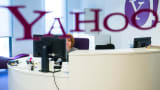 An employee works at her desk inside the office at the Yahoo Inc. headquarters.