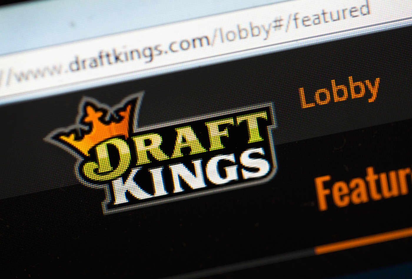 Stocks making the biggest moves midday: DraftKings, Tesla, Macy's & more