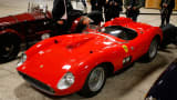 Visitors look at a red 1957 Ferrari 335 Sport Scaglietti model on display at the Paris Retromobile fair in Paris, France, February 5, 2016.