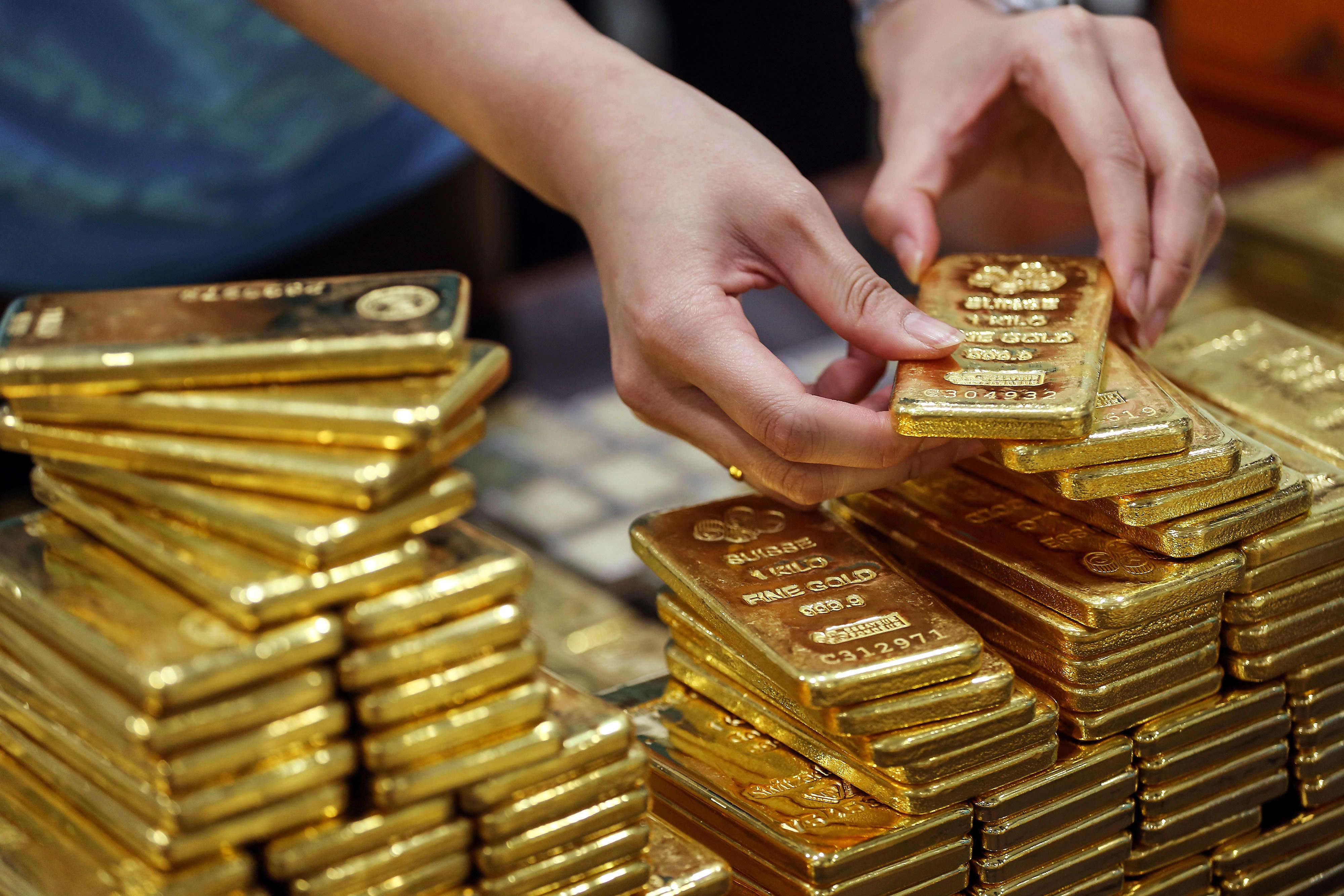 Palladium drops over 5% as investors lock in profits; gold subdued