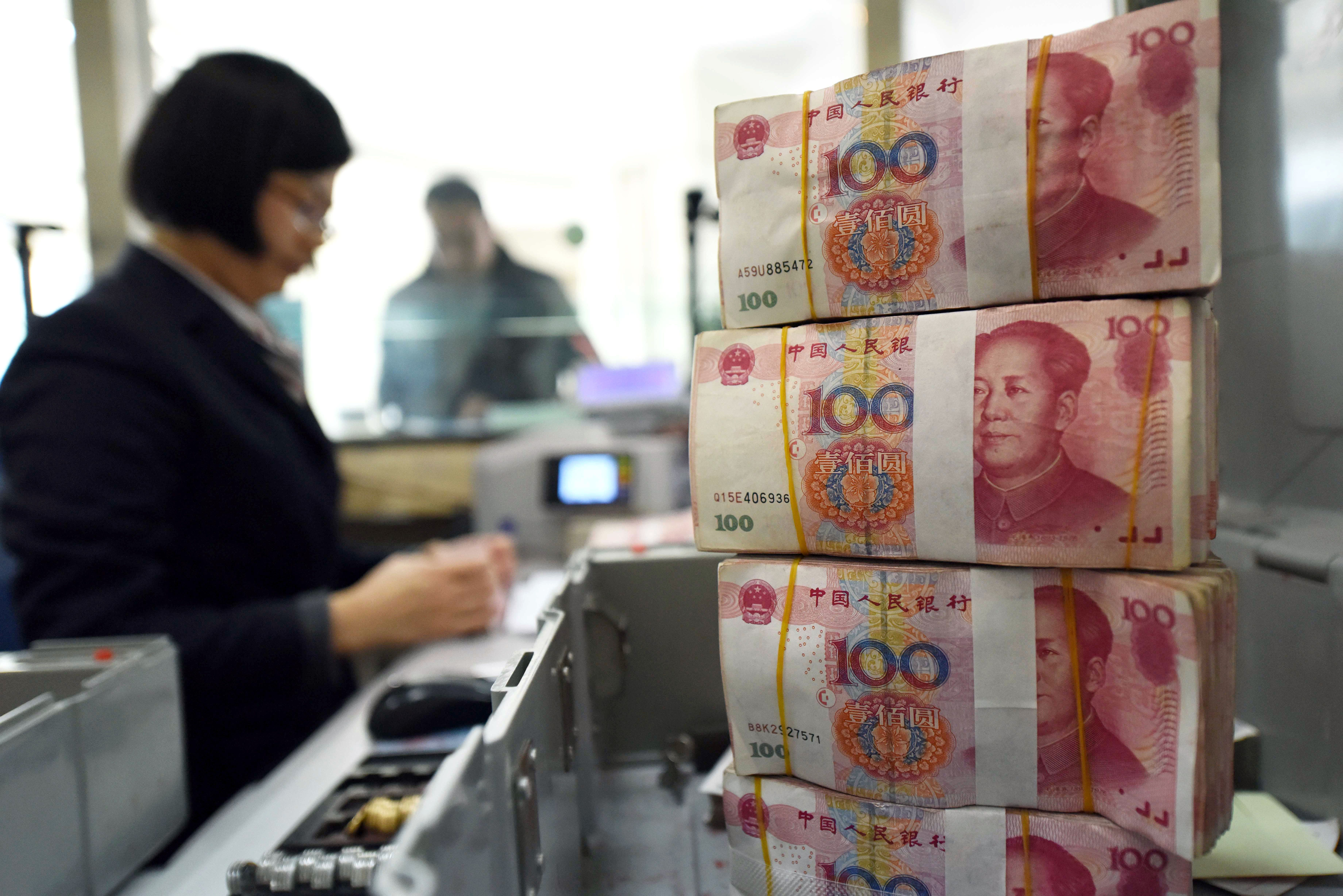 China fixes yuan midpoint at 7.0211 on Monday — weaker than 7 for three consecutive sessions