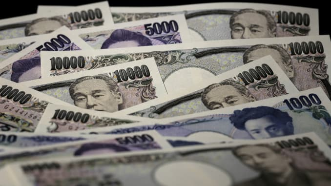 Japanese yen banknotes of various denominations are arranged for a photograph in Tokyo, Japan, on July 22, 2015.