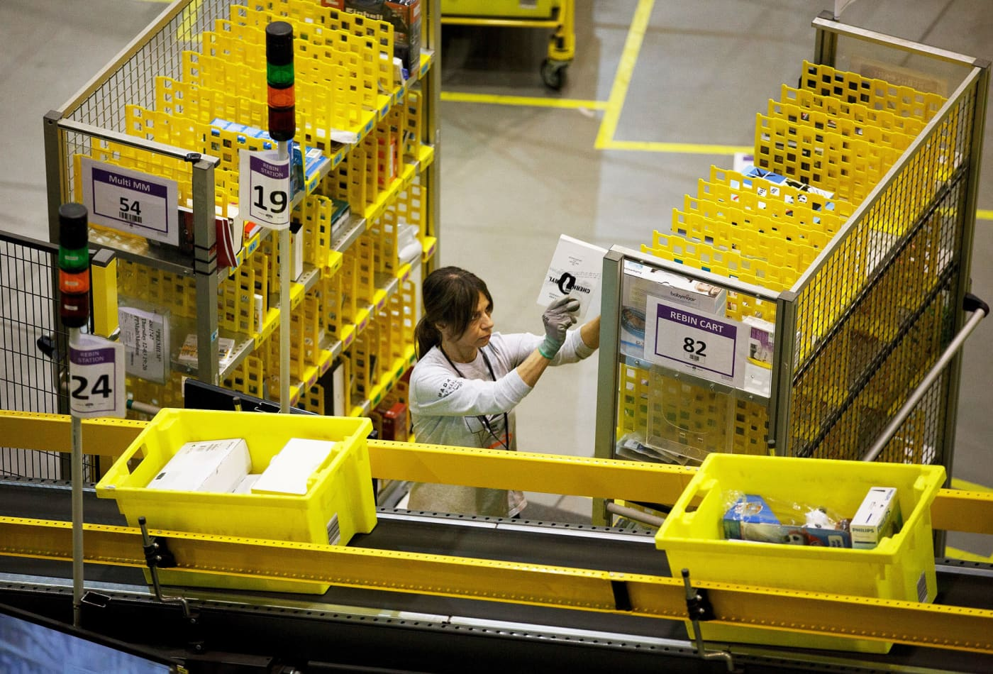 Amazon is testing a wearable device that lights up and beeps when warehouse workers get too close to each other