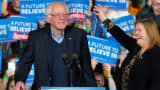 Democratic U.S. presidential candidate and U.S. Senator Bernie Sanders is accompanied by his wife Jane as he arrives on stage at his Super Tuesday rally in Burlington, Vermont March 1, 2016.