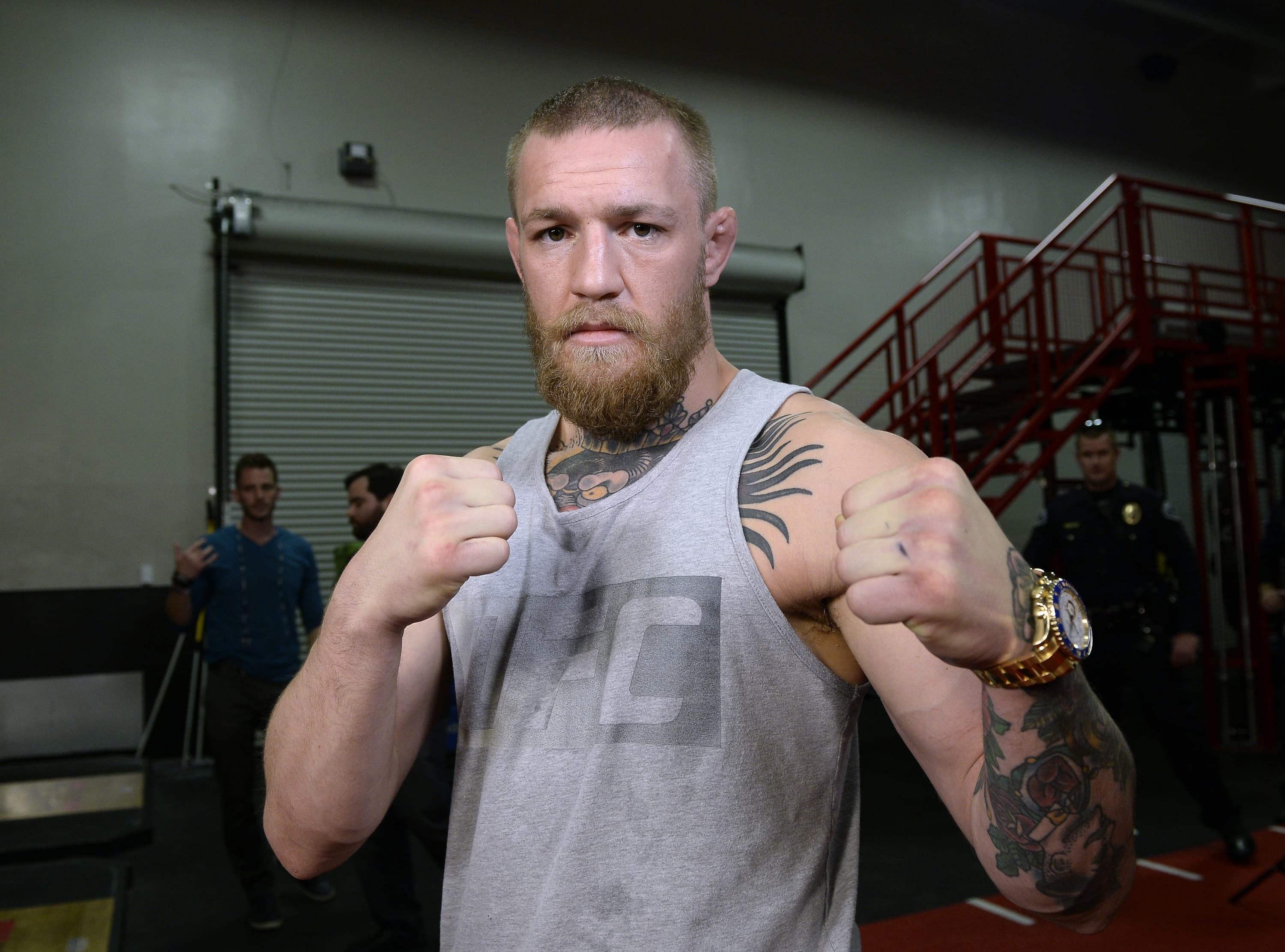 UFC featherweight champion Conor McGregor poses after a news conference with lightweight contender Nate Diaz at UFC Gym February 24, 2016, in Torrance, California.