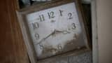 A stopped clock covered in five years of dust, sits in tsunami damaged home inside the exclusion zone close to the devastated Fukushima nuclear plant. The area is now closed to residents due to radiation contamination from the Fukishima Nuclear Disaster on February 26, 2016 in Okuma, Japan.