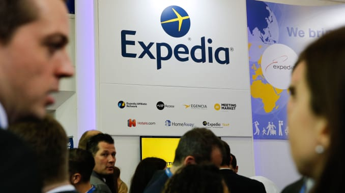 Visitors browse at the display of Expedia during the International Tourism Trade Fair in Berlin.