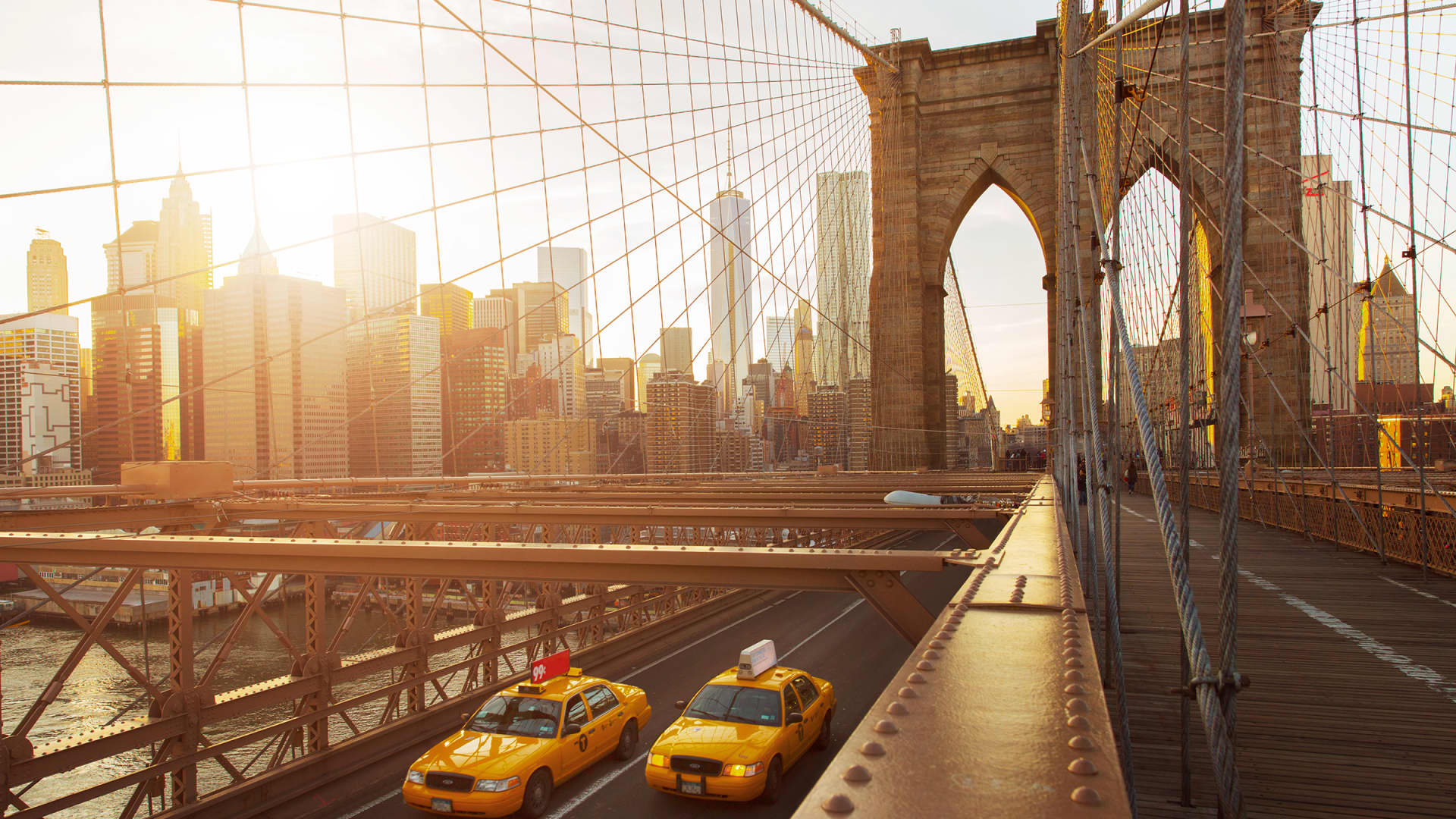 New York City and its borough of Brooklyn both placed among the most expensive U.S. destinations. Pictured, the Brooklyn Bridge and lower Manhattan.