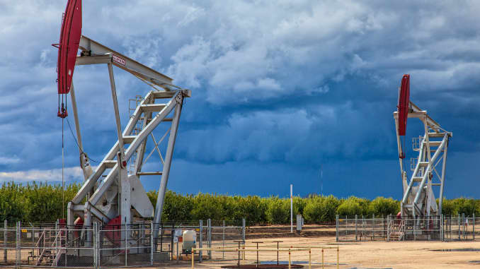 Premium: Storm clouds oil derricks pumpjacks