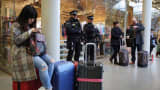 Armed Police Officers stand at the entrance to the Eurostar at St Pancras Station on March 22, 2016 in London, England.