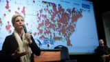 Activist Erin Brockovich uses a computer model to display the growing environmental hot spots as she speaks during an Oklahoma Earthquake Town Hall Meeting at the University of Central Oklahoma February 23, 2016.