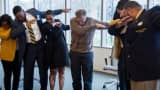 A tweet showing Bill Gates dabbing with students.