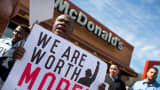 Demonstrators gather in front of a McDonald's restaurant to call for an increase in minimum wage on April 15, 2015 in Chicago, Illinois.