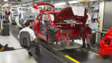 The chassis of Adam Opel AG automobiles move along the production line at the Opel factory, operated by General Motors Co. (GM), in Eisenach, Germany.