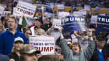 Supporters cheer for republican presidential candidates Donald Trump