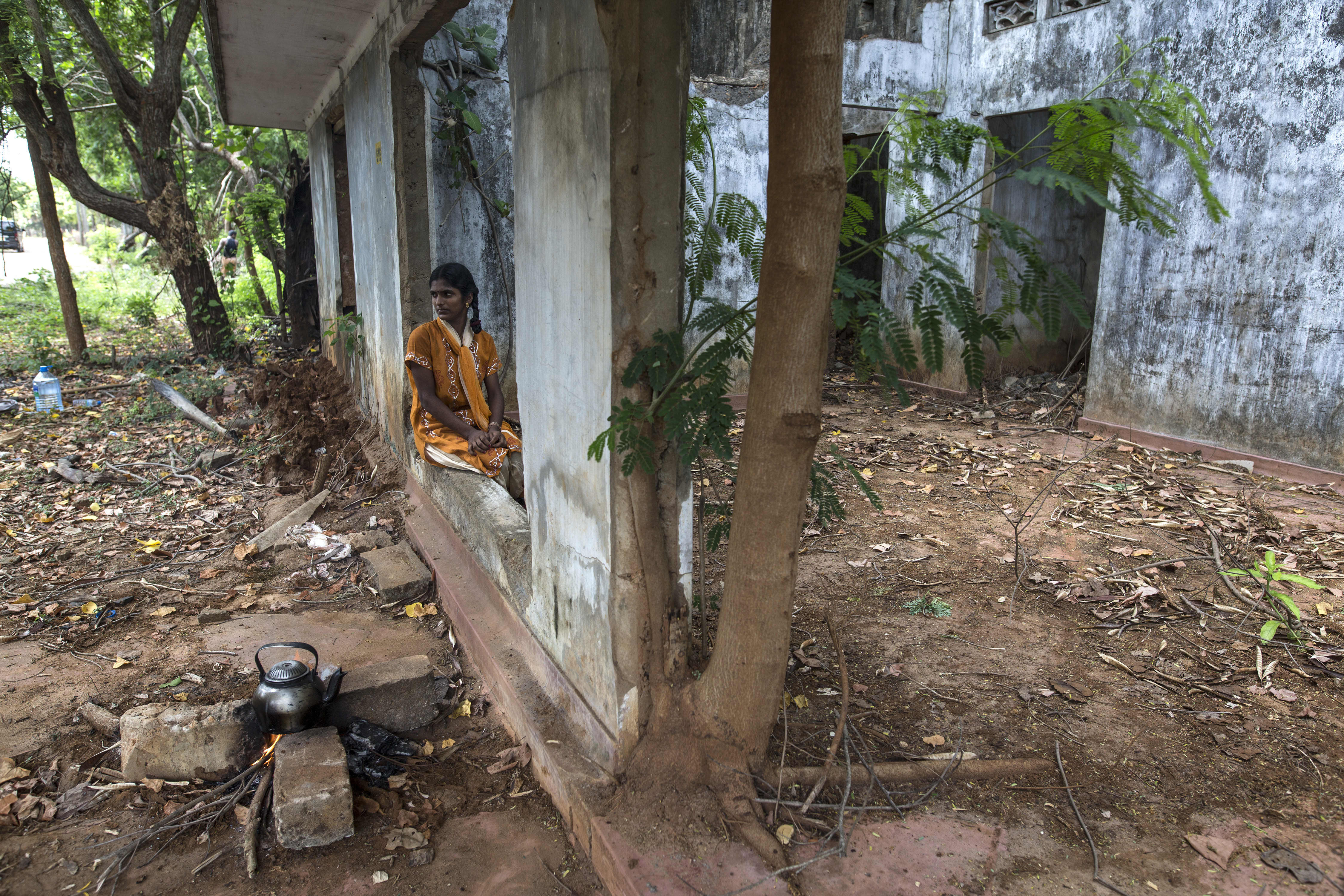 Kasthari Udayakumaran sits in a vacant home belonging to her family in Tellippalai, Jaffna--an area that used to be a high security zone. Recently, it was released back to the land owners by the Sri Lankan military.