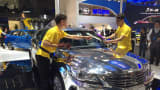 The mirrored finish on the Raeton, manufactured by China's Changan Auto, requires two attendants to maintain maximum shine