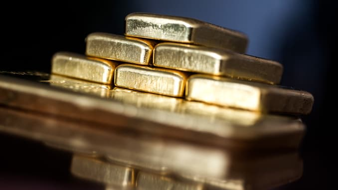 Two hundred and fifty gram gold bars sit stacked in this arranged photograph at Solar Capital Gold Zrt. in Budapest, Hungary.