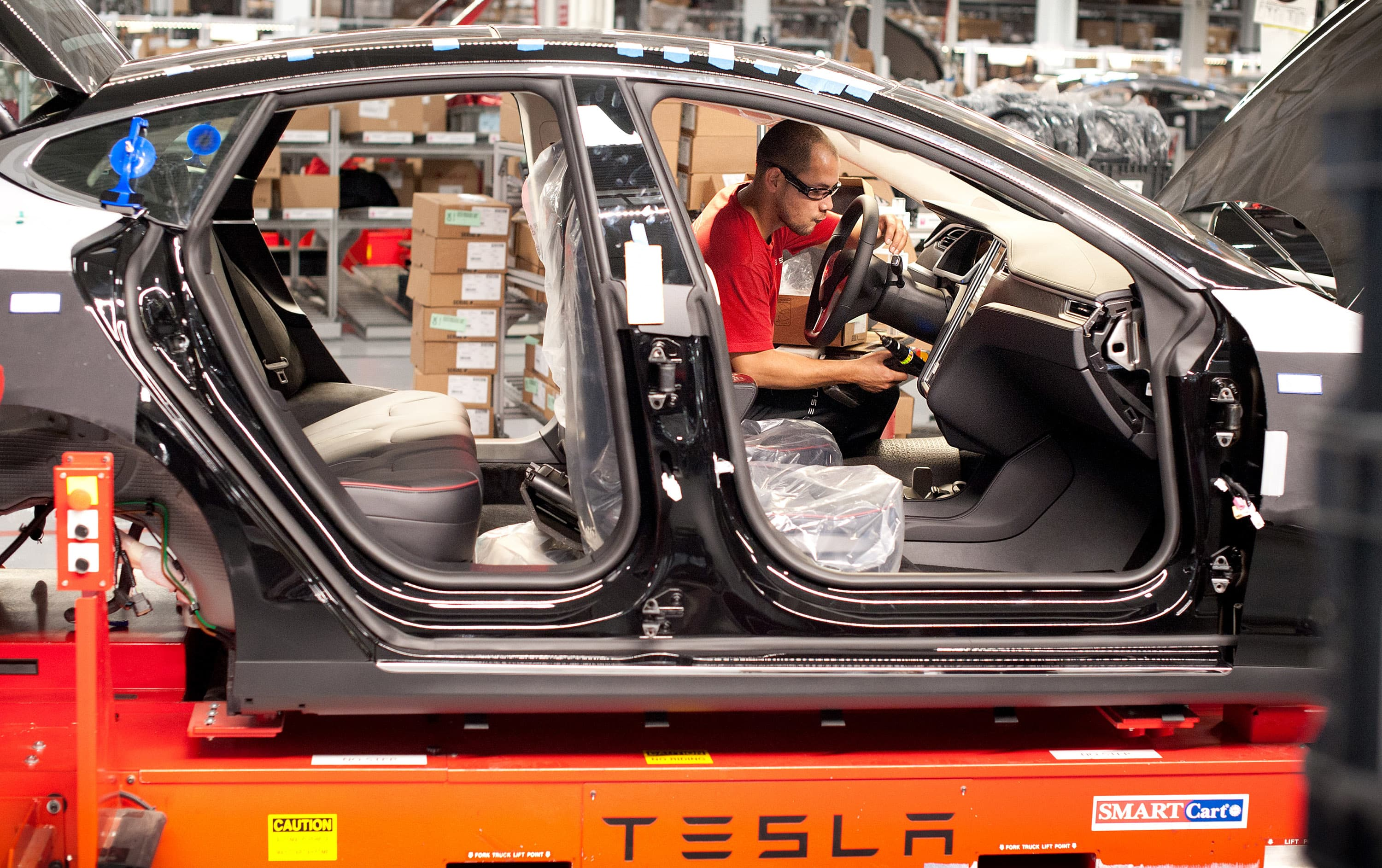 Tesla production briefly halted by paint shop fire in