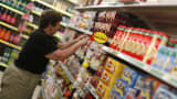 An employee arranges merchandise at a Dollar General store in Arvada, Colorado.