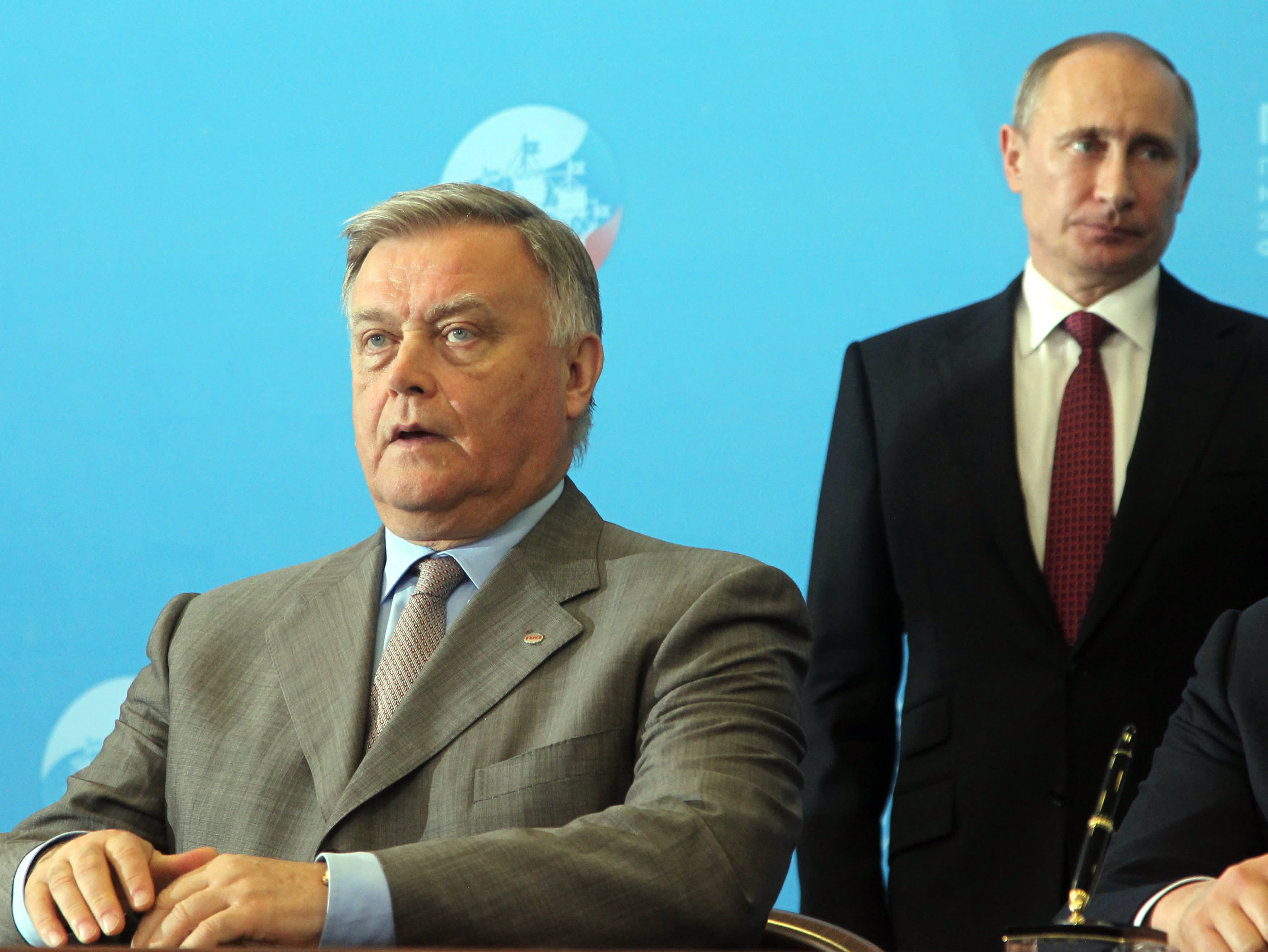 Vladimir Yakunin (left) and Russian President Vladimir Putin at the Saint Petersburg Economic Forum in 2013