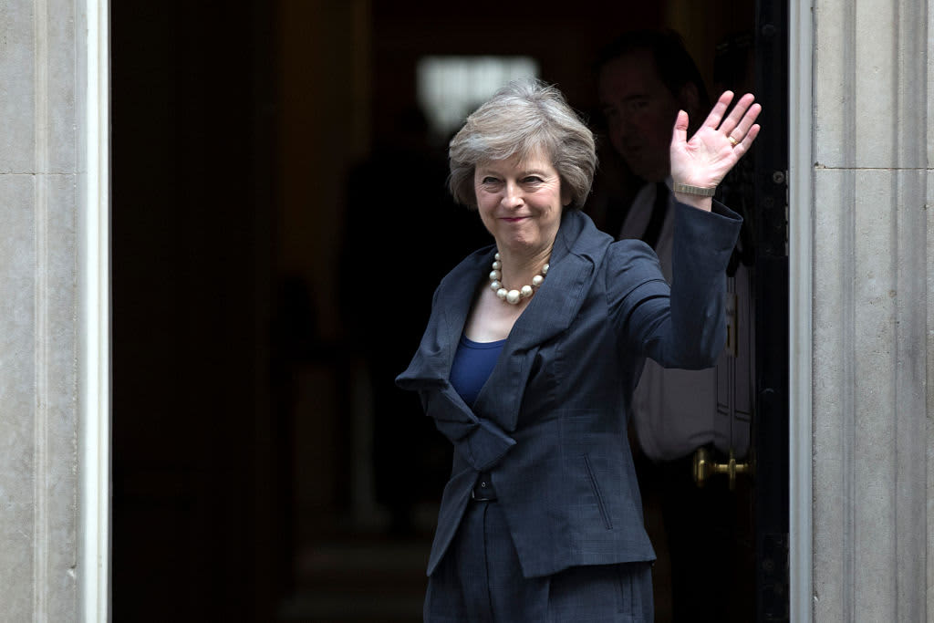 : Prime Minister-in-waiting, Theresa May waves as she arrives for a Cabinet meeting at Downing Street on July 12, 2016 in London, England.
