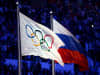 The Olympic flag and Russian flag are raised as the Russian National Anthem is sung during the 2014 Sochi Winter Olympics Closing Ceremony at Fisht Olympic Stadium on February 23, 2014 in Sochi, Russia.