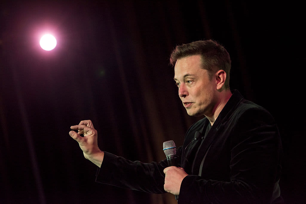 tesla ceo elon musk says he was raised by books