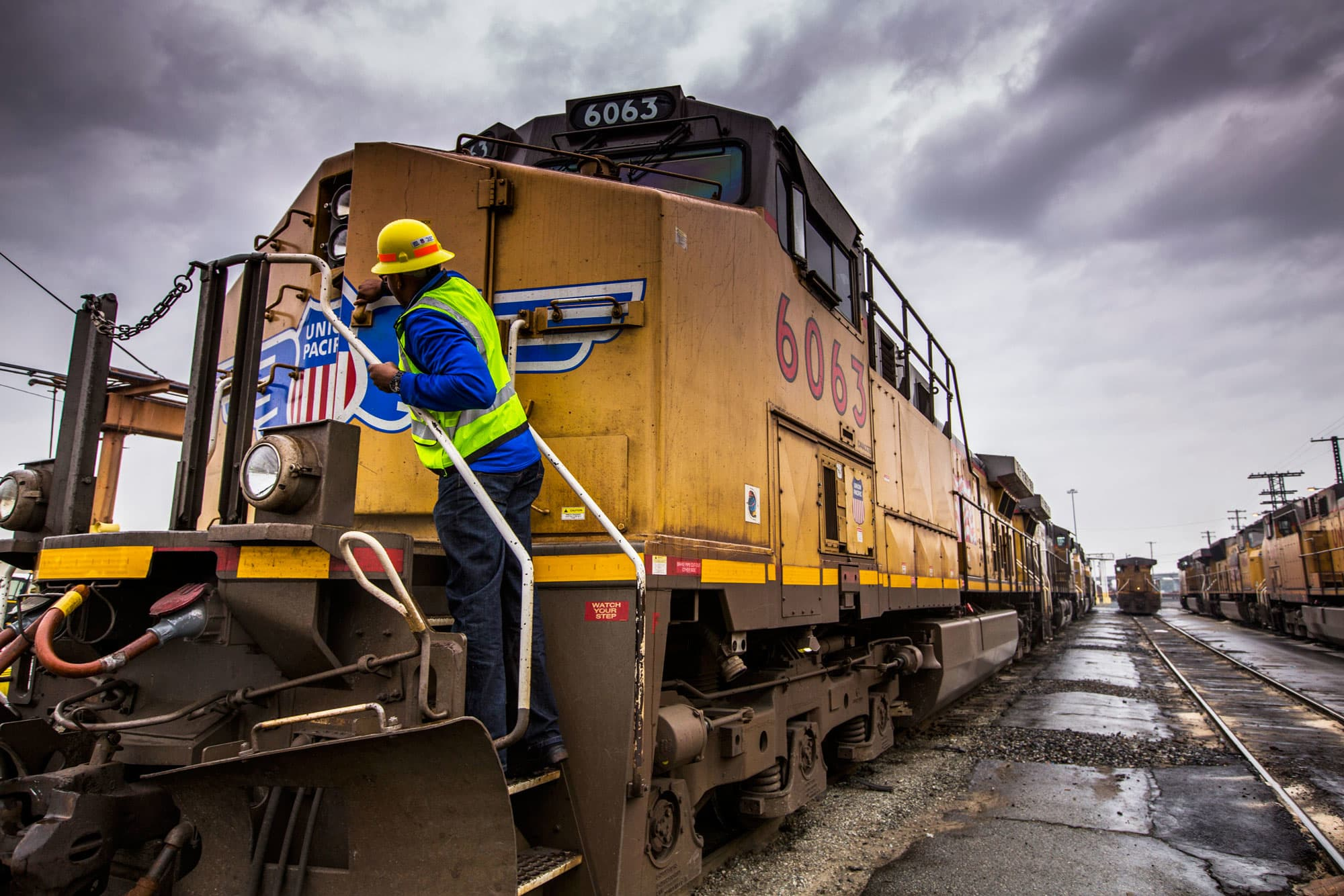 A Union Pacific employee closes the entry door on a rail car at the company's facility at the Port of Oakland in Oakland, California.