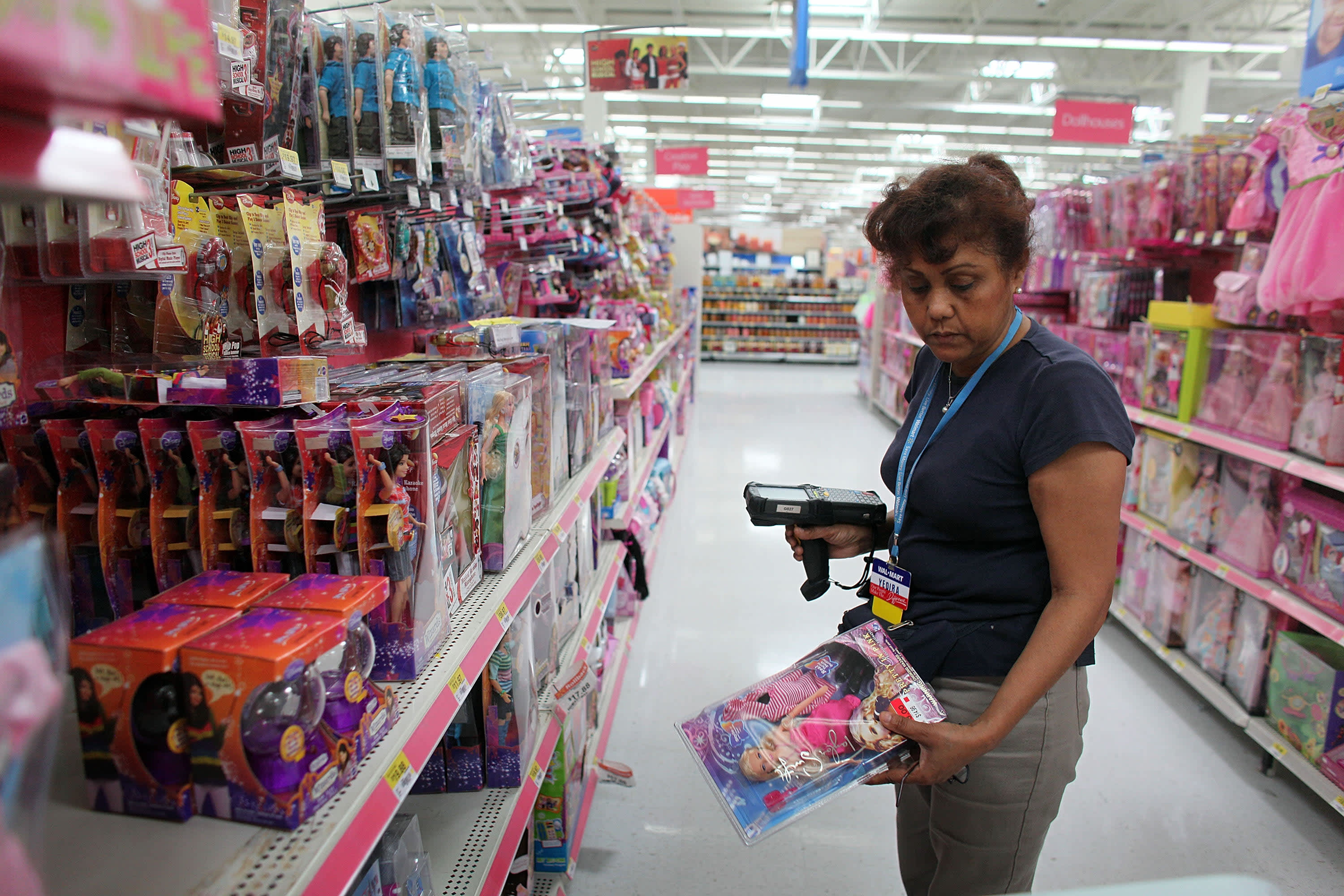 A Wal-Mart employee restocks the shelves in the toy department in Pompano Beach, Florida.