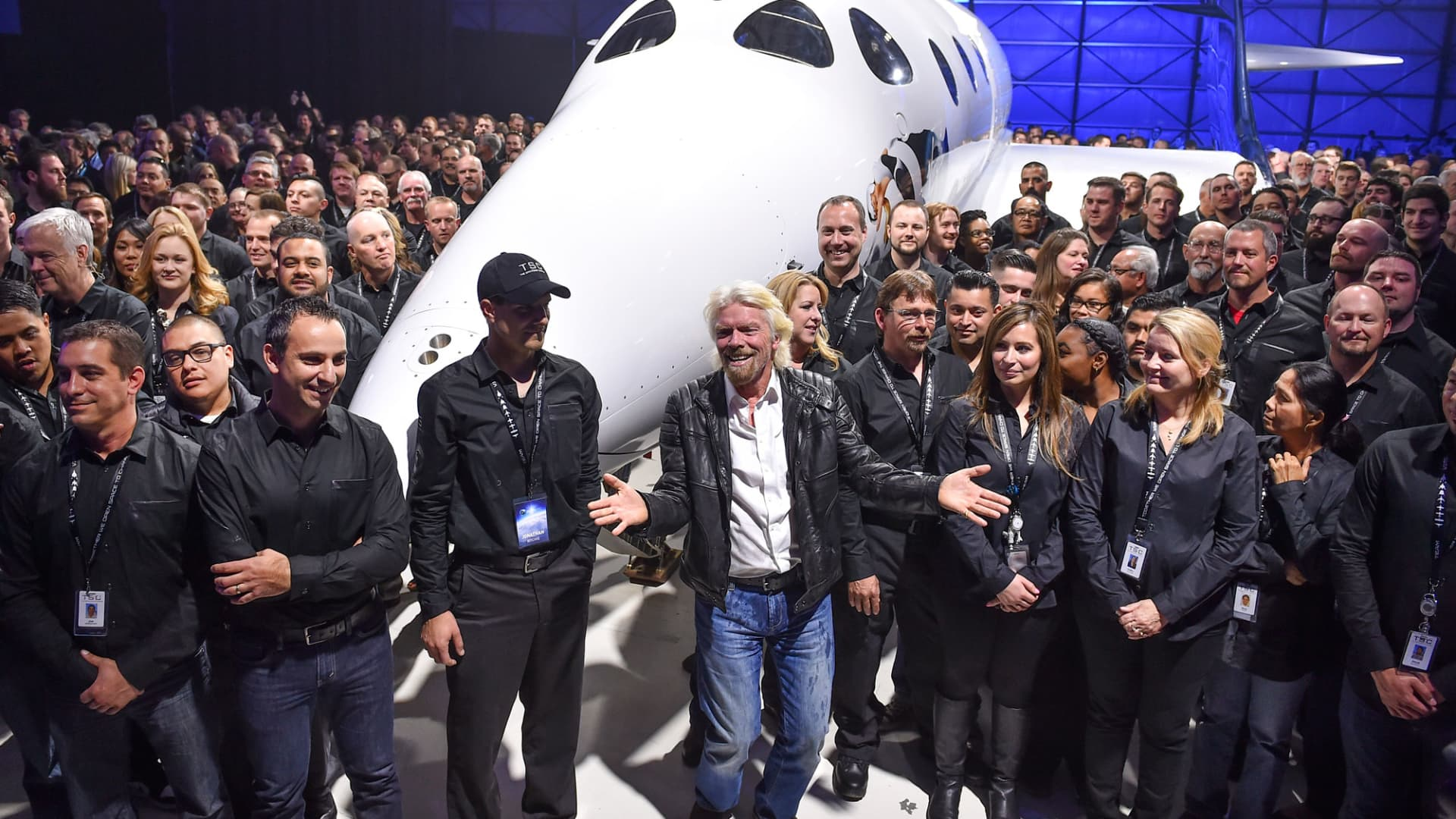 Virgin Galactic's Richard Branson, front center, gathers with Virgin Galactic employees in front of the new SpaceShip Two VSS Unity after a roll-out ceremony of the new aircraft at the Mojave Air and Space Port on February 19, 2016 in Mojave, Ca.