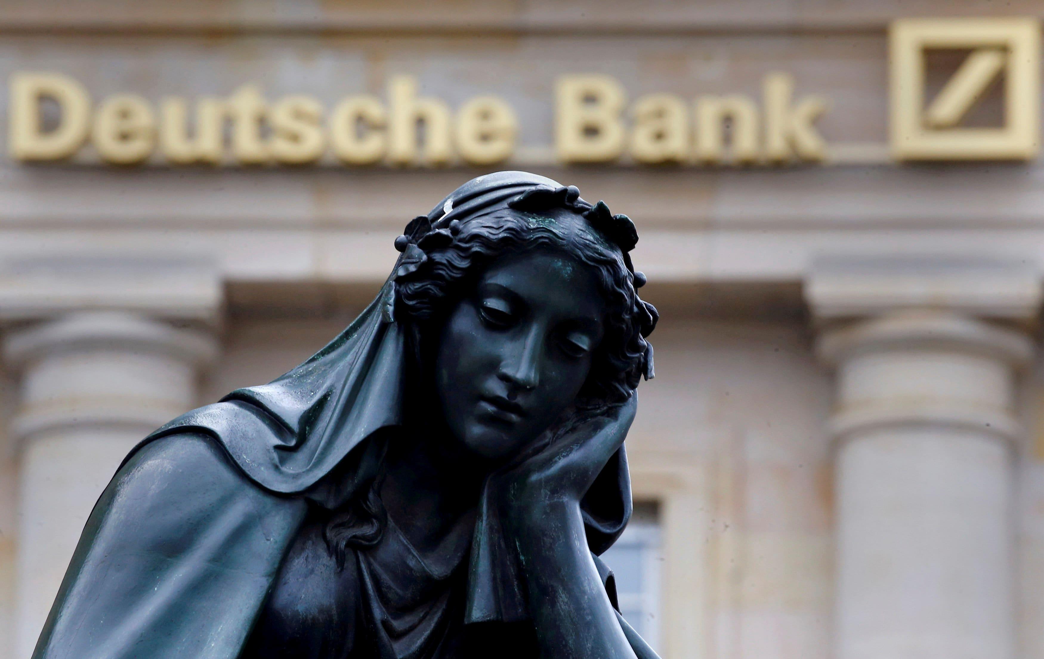 European markets close lower despite strong US job growth; Deutsche Bank shares fall 5% as restructuring begins