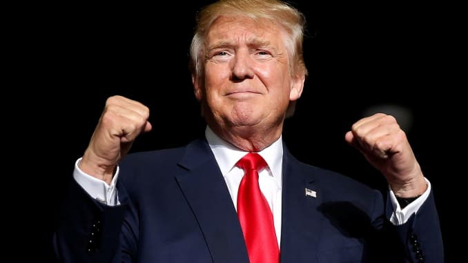 RT: Donald Trump, happy and fists up