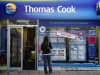 A woman looks at holidays for sale in a Thomas Cook travel agent window in Bristol, England.