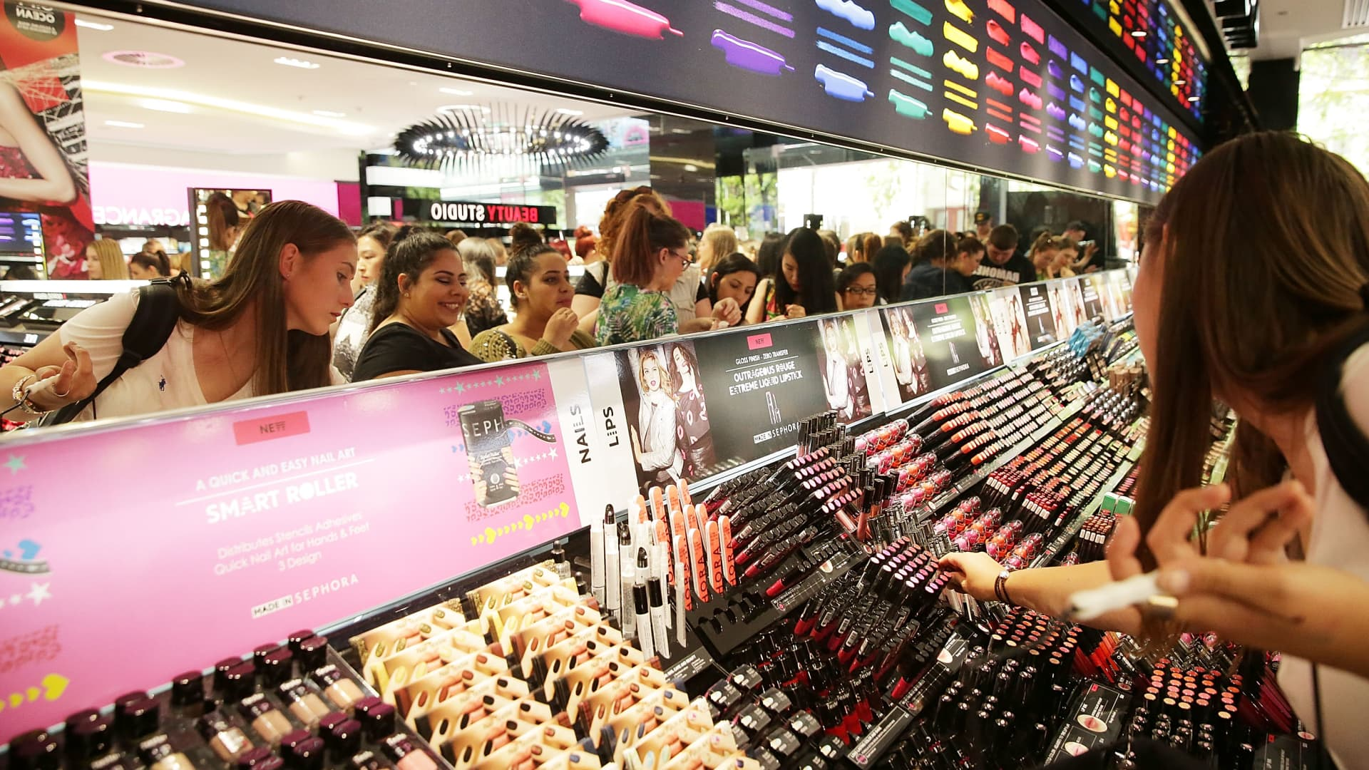 Customers shop for makeup at a Sephora store.