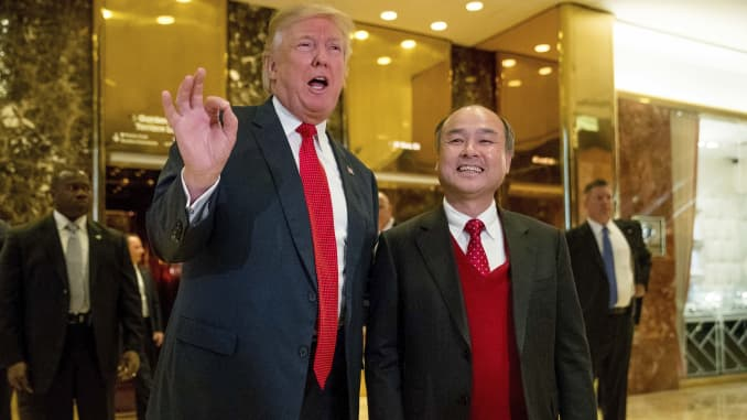 ONE TIME USE AP President-elect Donald Trump, accompanied by SoftBank CEO Masayoshi Son 161206