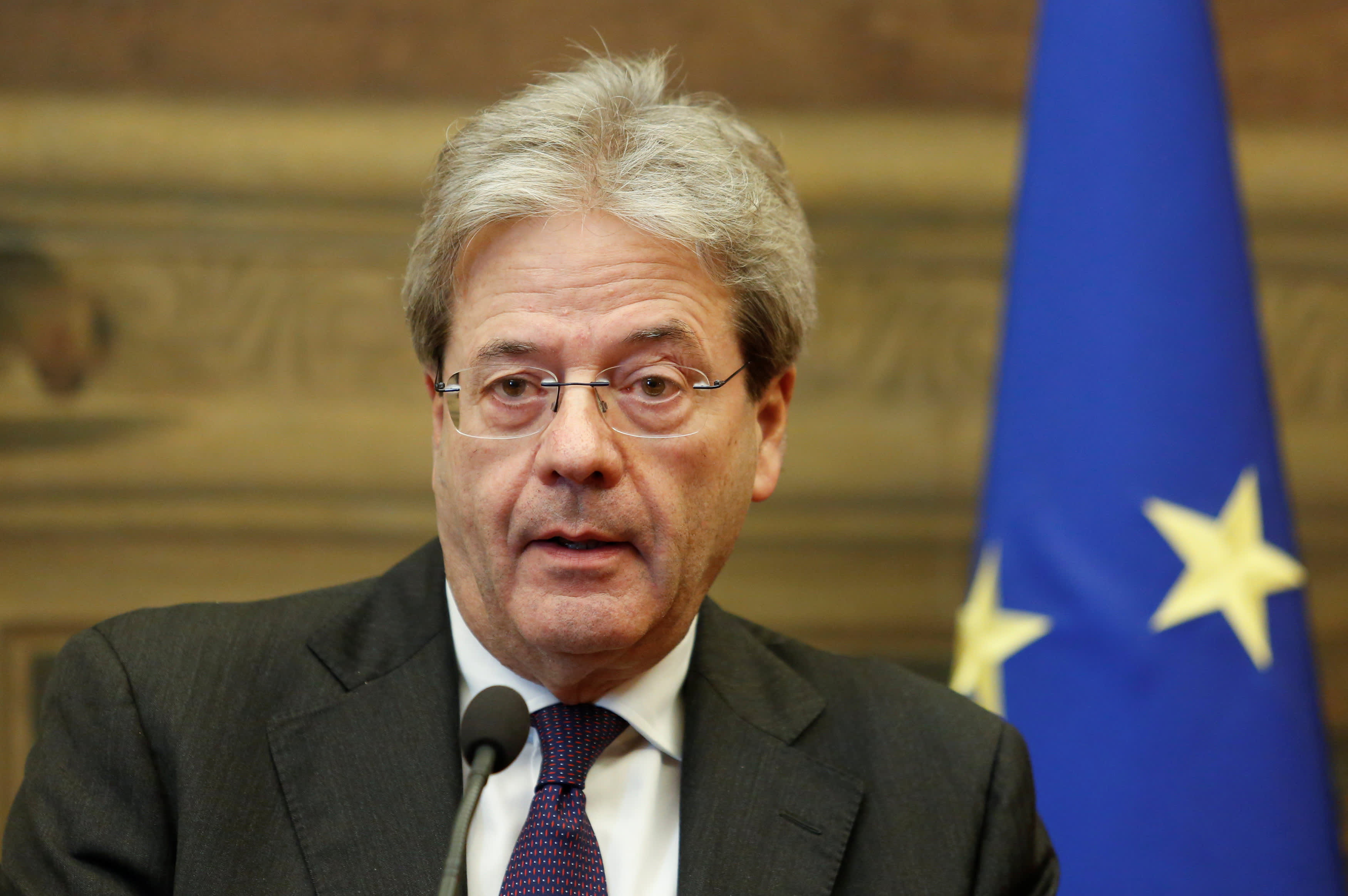 Italian Prime Minister-designate Paolo Gentiloni speaks to journalists at the end of a meeting in the Low Chamber in Rome, Italy December 12, 2016.
