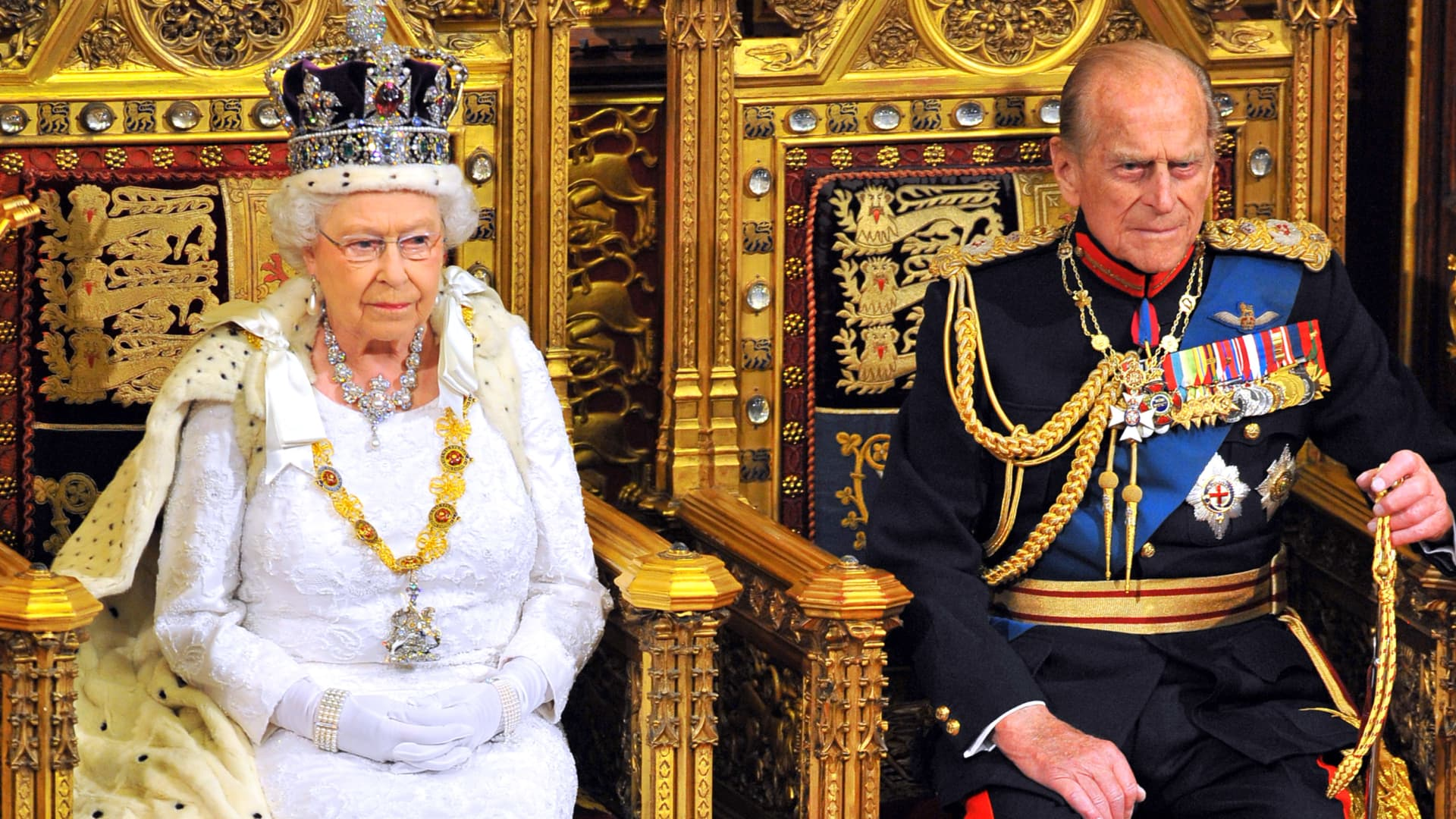 Queen Elizabeth II sits with Prince Philip as she delivers her speech during opening ceremony of Parliament in the House of Lords at Westminster on June 4, 2014, in London.