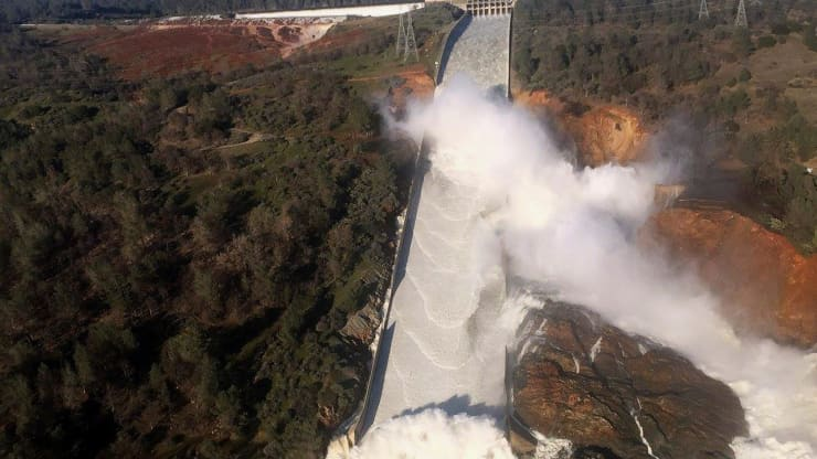 aerial photo of Lake Oroville, California dam with damaged spillway and eroded hillside, 11 February 2017 | photo credit Robyn Beck for AFP Getty Images
