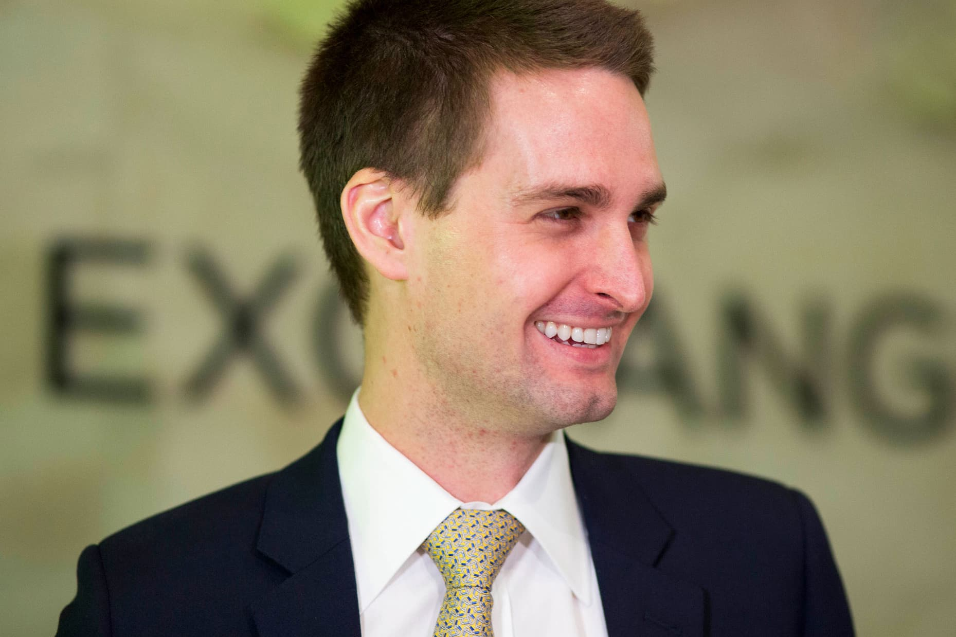 Snap Inc. CEO Evan Spiegel smiles before ringing the opening bell at the New York Stock Exchange as his company celebrates its IPO, Thursday, March 2, 2017.