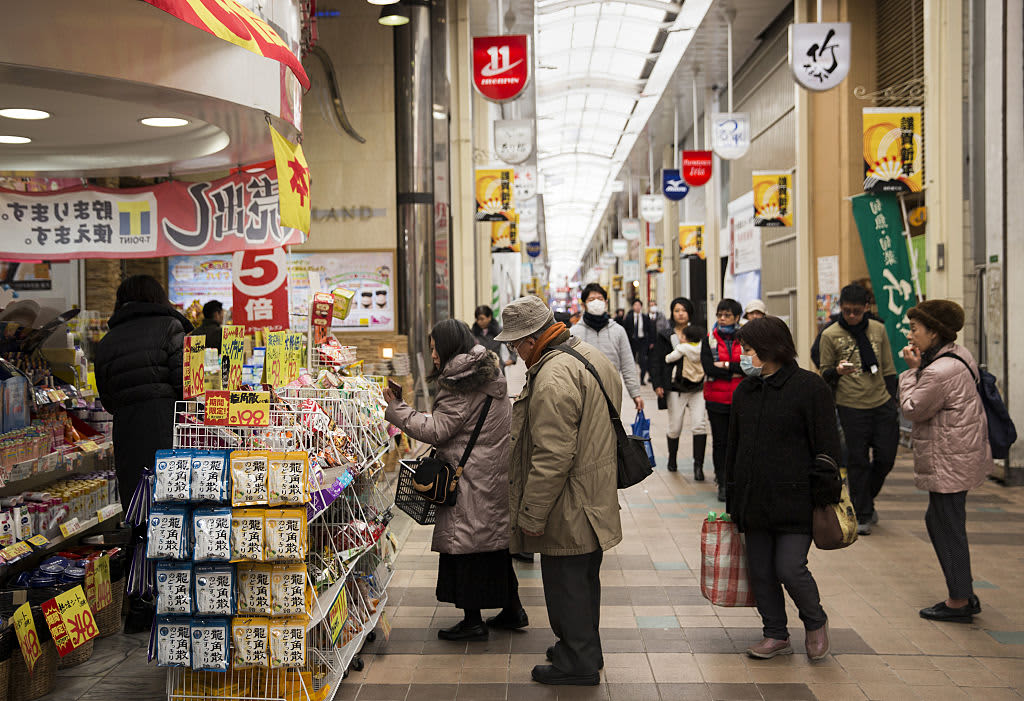 Japan's households cut spending amid impacts from sales tax, typhoon
