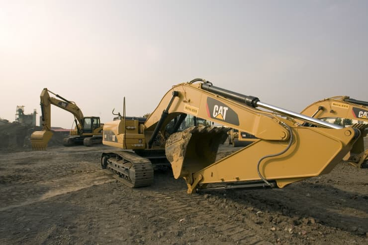Premium: Machinery made by Caterpillar Inc. operates at a demonstration in Tianjin, China