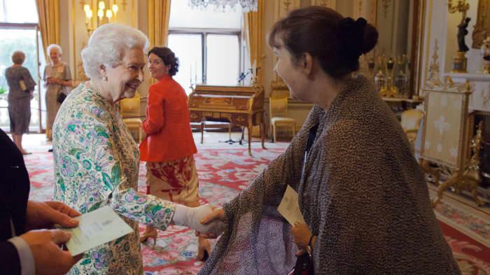 HANDOUT Julie Deane meeting the Queen of England