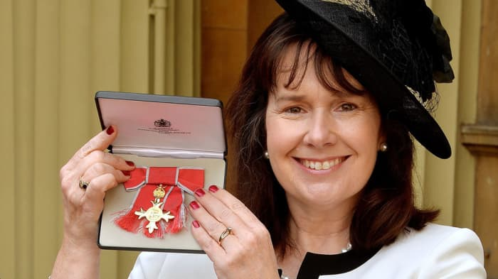 HANDOUT Julie Deane with her Order of the British Empire award